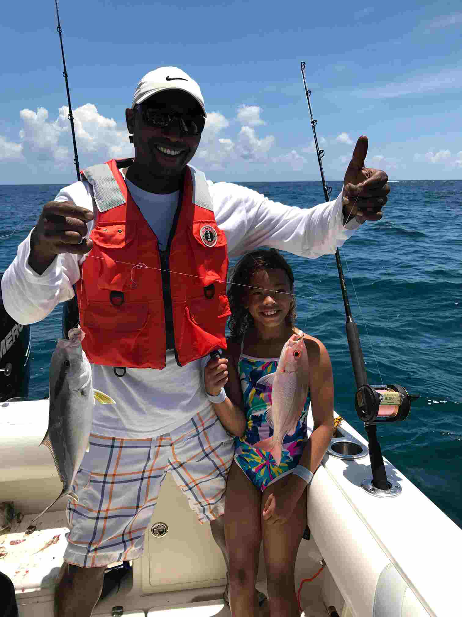 David and Marley with a doubleheader - strawberry snapper and blue runner