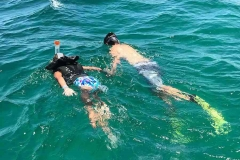 Mate Jack takes 8 year old Marley for a snorkel tour of the Lobsta Wreck
